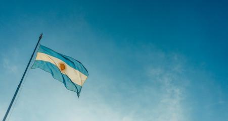 Argentina flag waving against blue sky on a sunny day