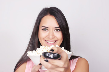 Young caucasian woman watching a movie / TV