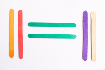 colorful of Ice cream sticks with equals sign on white background