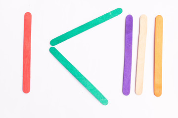 colorful of Ice cream sticks with less than sign on white background