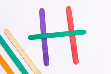 colorful of Ice cream sticks with word H on white background