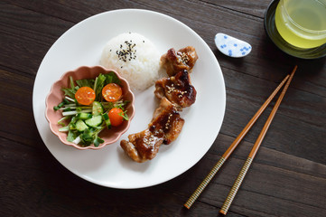 Chicken Teriyaki is marinated chicken grilled over charcoal, then ladled with savory sweet sauce.