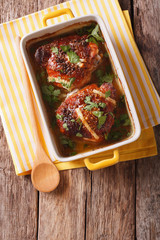 Chicken thighs with onion baked in honey-mustard sauce. Vertical top view