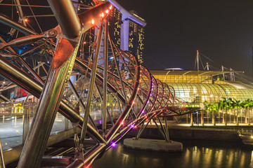 SINGAPORE, SINGAPORE - SEPTEMBER 28, 2013 : Night view of Helix bridge which leading to Marina Bay Sands luxury hotel, a famous tourist attraction of Singapore.