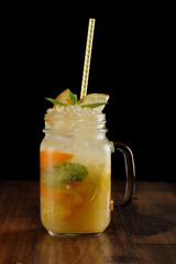 orange, lemon and lime mix. fresh cocktail. citrus juice. black background