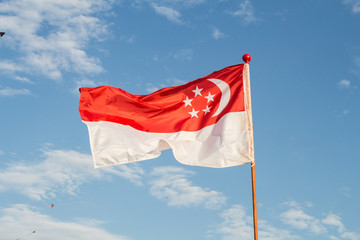 singapore nation flag in blue sky