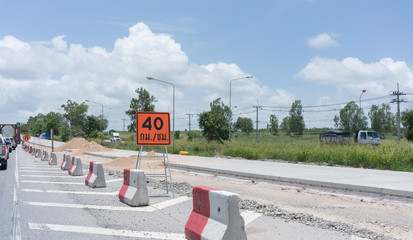 Road construsting on route Bangkok - Rayong with speed limit sign , not more than 40 km. /hour causing traffic jam , Thailand