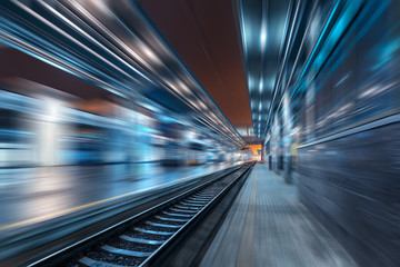 Foto op Plexiglas Londen rode bus Railway station at night with motion blur effect. Railroad