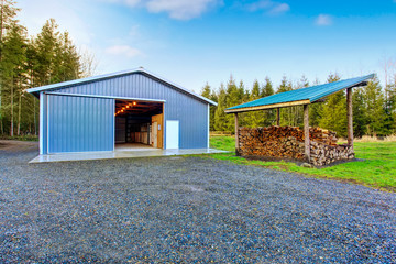 Farm blue barn shed and gravel driveway. Wall mural
