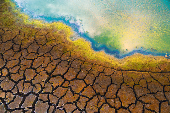 Polluted water, oil spill, cracked soil, summer drought