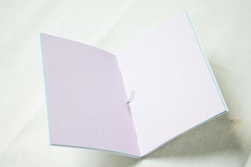 Opened  blank purple notebook