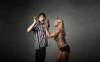 female wrestler hit with referee