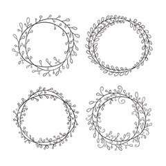 Set of round frames, hand-drawn. Round frame made of branches with leaves and berries.  Wreath painted by hand.