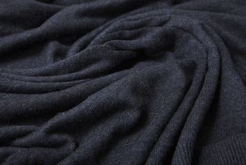 A full page of black fine knit fabric texture