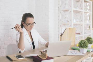 Attractive woman doing paperwork