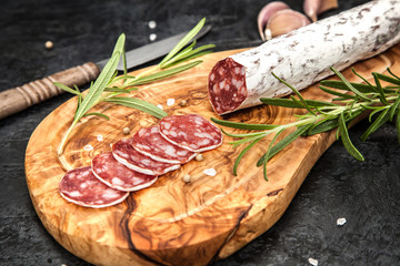 Salami on dark background