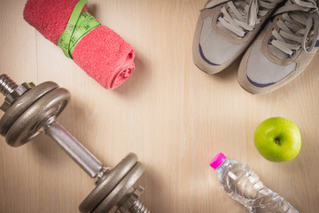 Sport and fitness objects on wooden background