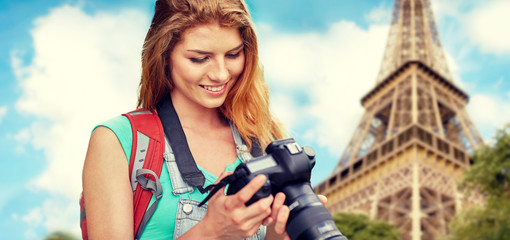 woman with backpack and camera over eiffel tower