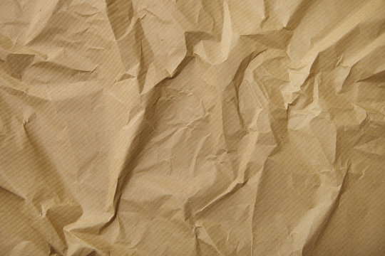 A full page of scrunched up brown craft paper texture