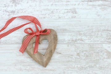 wooden heart lying on wood