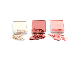 collection of various make up powder on white background