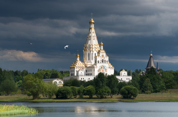 All Saints Church In Minsk, Belarus. Memorial church of All Saints and in memory of the victims, which served as our national salvation.Church with gold domes, stormy sky and flying seagulls.