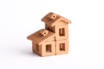 Small toy house assembled with earthenware pieces