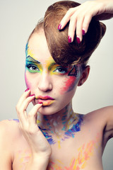 elite girl with beautiful hairstyle and bright makeup