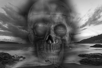 Skull on a sea, sad and bad weather background ,concept hallowee