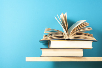 Open book, hardback books on wooden table. Education background. Back to school. Copy space for...
