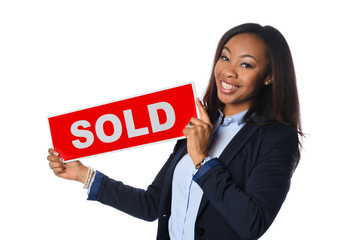 Young Woman Holding Sold Sign