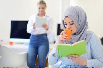 Arabian Businesswoman in startup office with team working in the