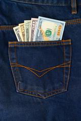 Dollar Bills in the pocket of jeans