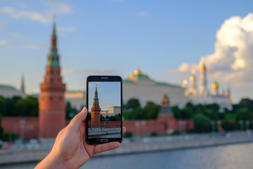 Man taking picture of Moscow Kremlin landmarks