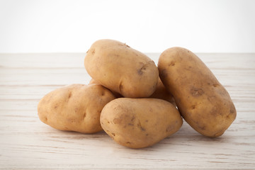 potato still life on wood background