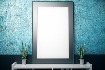 Blank frame on textured blue wall