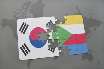 puzzle with the national flag of south korea and comoros on a world map background.