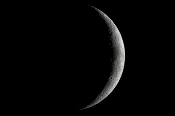 Moon waxing crescent. Young Moon. Crescent moon on black sky. Waxing Crescent.