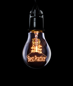 Hanging lightbulb with glowing Best Practice concept.