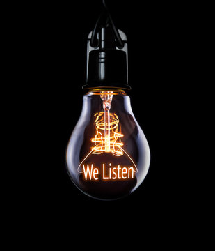 Hanging lightbulb with glowing We Listen concept.