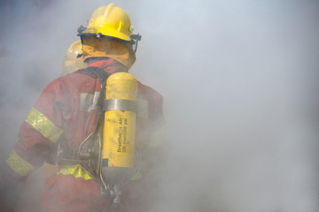 fireman in operation surround with smoke
