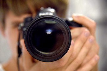 Self auto portrait camera lens in mirror photographer journalist
