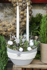 Christmas table decoration with white candles