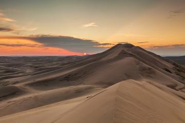 Colorful sunset over the dunes of the Gobi Desert. Mongolia.