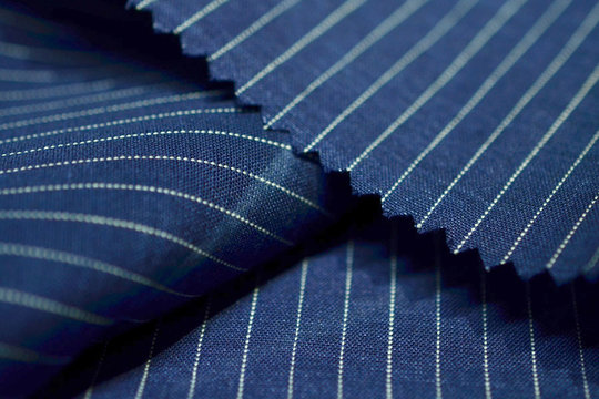 close up dark blue fabric of suit