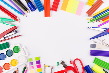 Office supplies arranged as frame on a white background. Back to school.Top view with copyspace