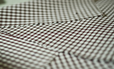 close up texture brown scott pattern fabric of shirt