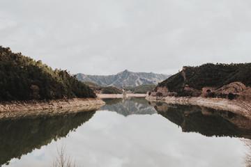Mountain lake under overcast sky