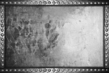 old grunge aluminum plate background with metal rivets