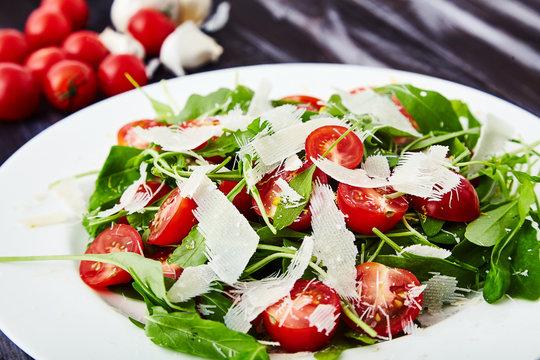 Close-up shot of tomatoes and arugula salad